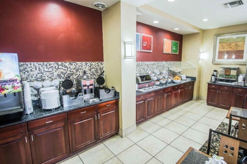 comfort suites near airport free breakfast area